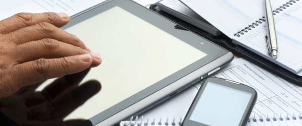 hand typing on digital tablet featured